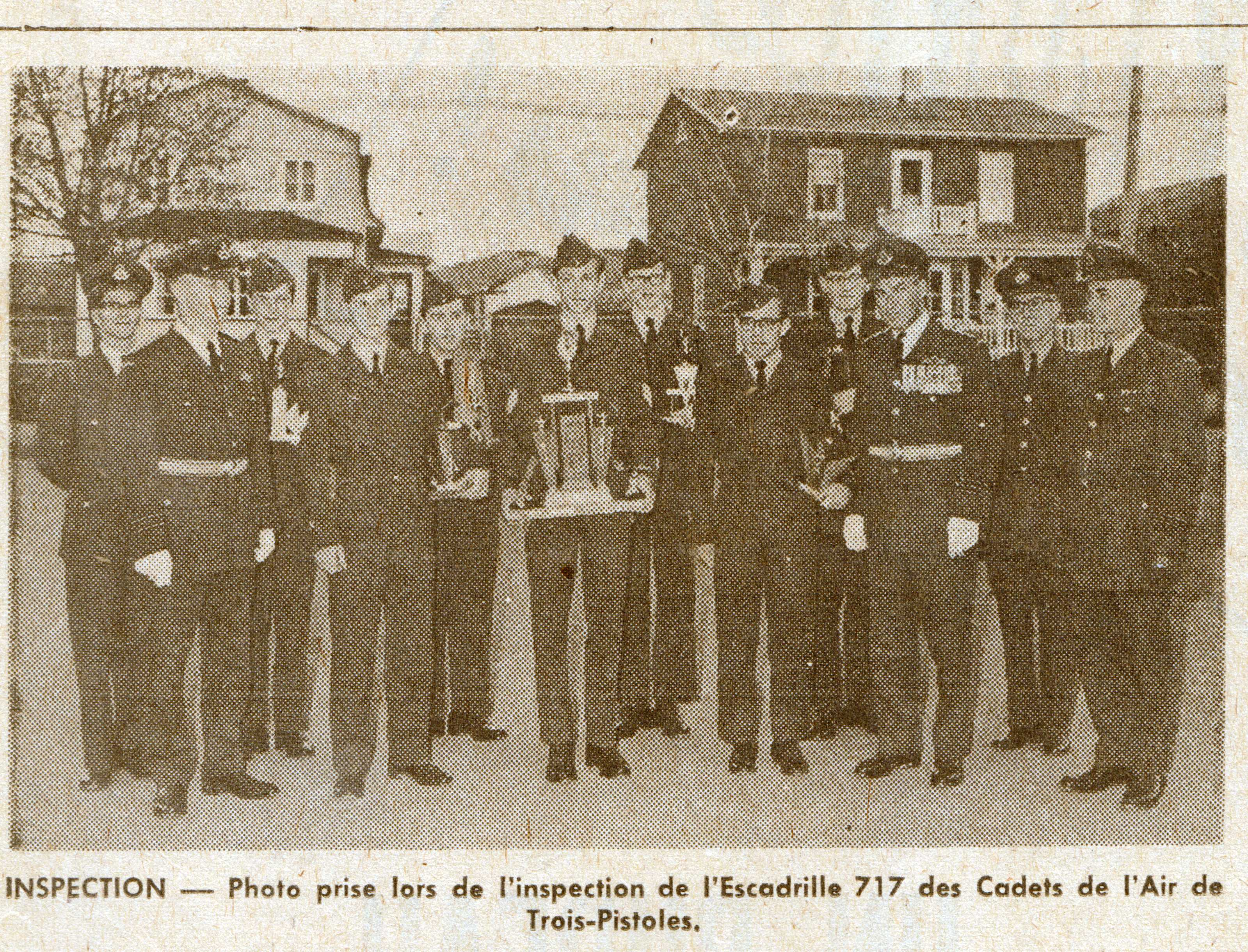 Photo: Newspaper photo of W/C Hubert Brooks with Air Cadets in Trois Pistoles