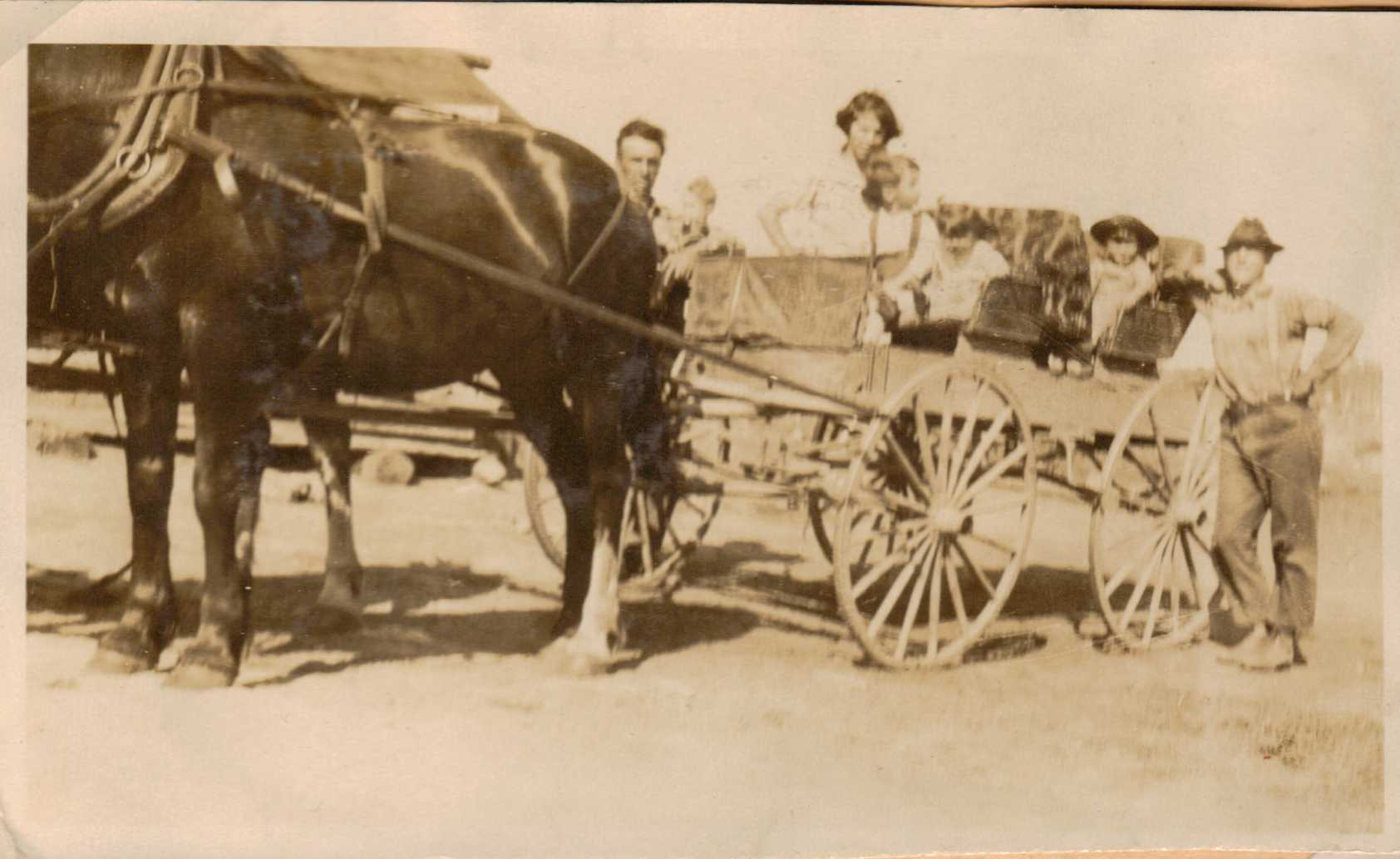 Hubert and Doris Brooks in Horse Drawn Wagon with Family Members