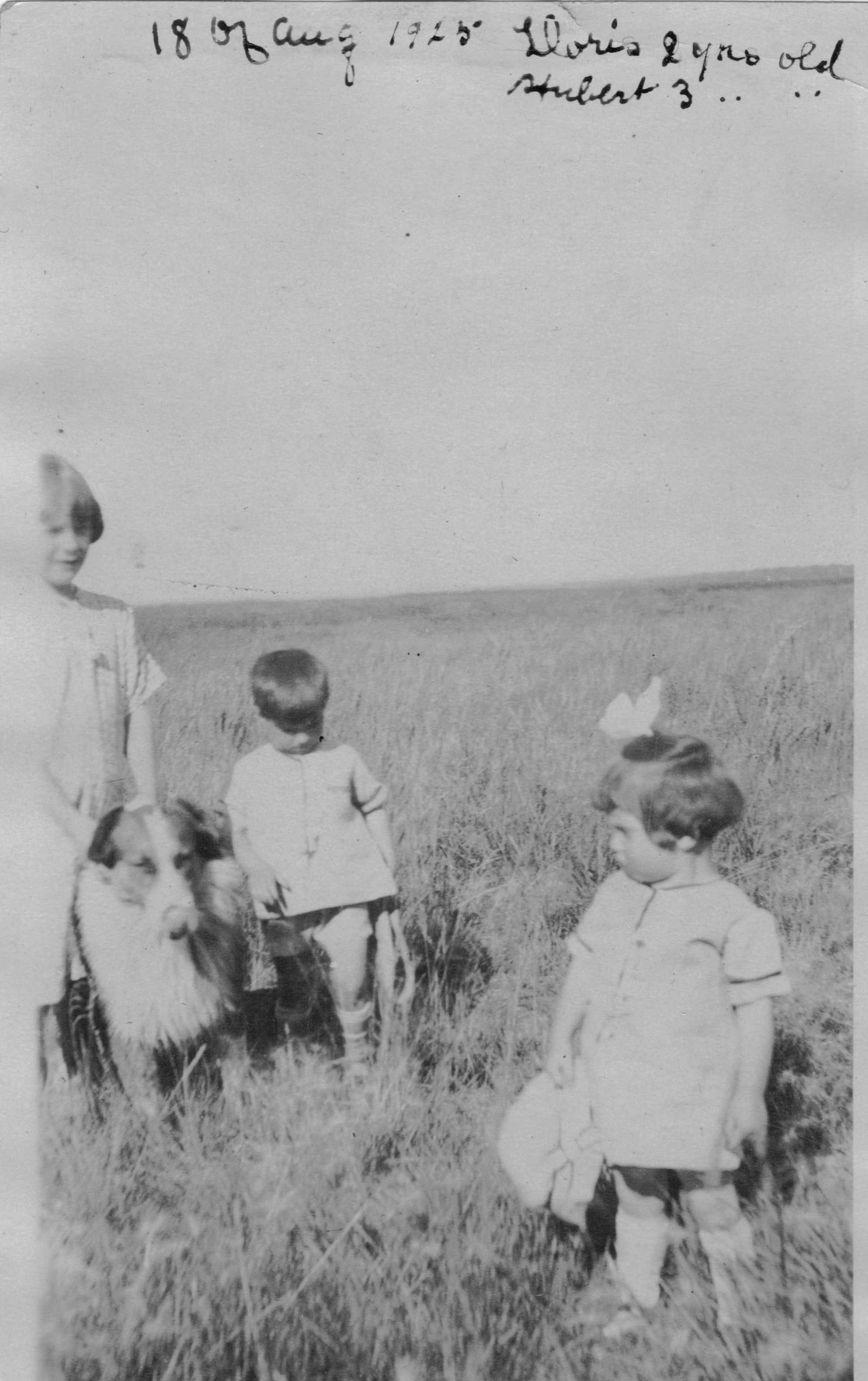 August 18, 1925 Doris and Hubert Brooks in Field With Dog