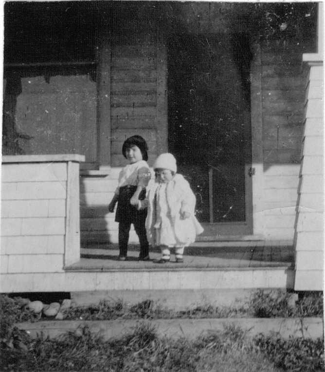 Hubert and Doris Brooks on Porch of Family Home 2