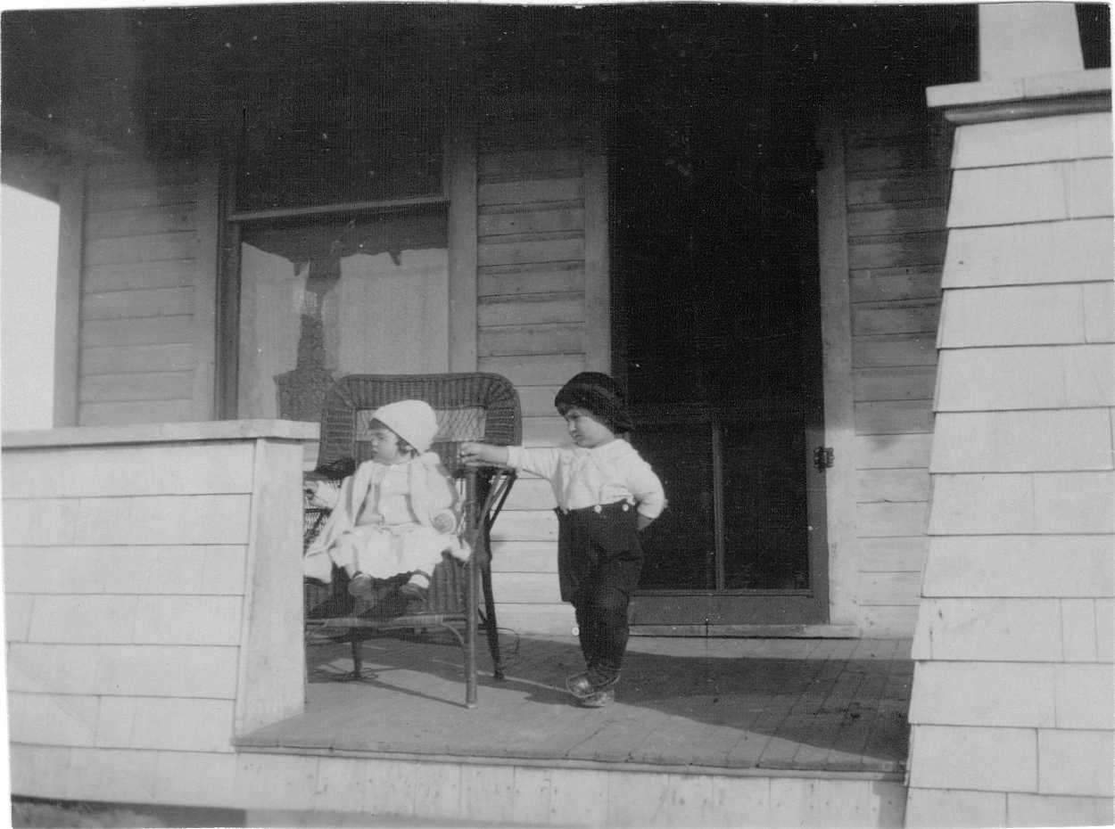 Hubert and Doris Brooks on Porch of Family Home 1