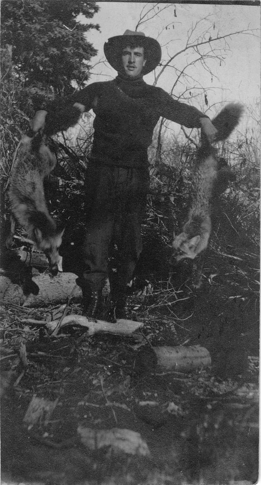 Photo of Aimé Brooks holding results of Fur Trapping Expedition Peace River